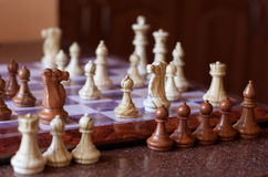Playing chess. Some chess pieces off the board Royalty Free Stock Images