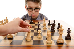 Playing Chess. Playing a game of chess.  White in play Stock Images