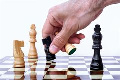 Playing chess. Chess player making his move Royalty Free Stock Photos