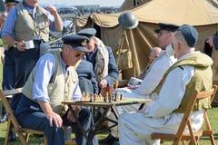 Playing chess awaiting scramble in World War Two reenactment Stock Image