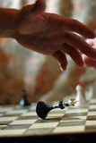 Playing chess game. defeating the King. Stock Image