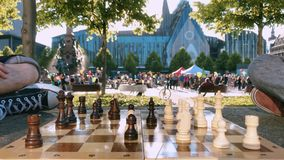 Playing chess on the lawn against the background of Augustusplatz Leipzig stock video