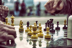 Playing chess. Two players play chess on a glass board Stock Photo