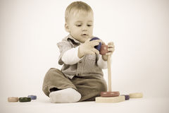 Playing child. Child plays and collects pyramids stock photography