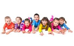 Playing children. Group of seven  playful children are lying on floor  together Stock Image