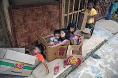 Playing children. BUKIT LAWANG, INDONESIA - AUGUST 18, 2012: children playing with boxes Stock Photos