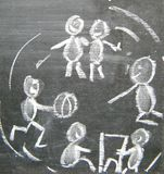 Playing children. A drawing on a blackboard of a group playing children Stock Images
