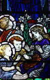 Playing children in stained glass. A stained glass photo of playing children stock photography