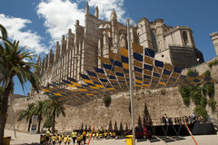 Children playing under the Cathedral of Palma Royalty Free Stock Image