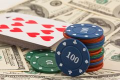 Playing chips and cards on a dollars Stock Image