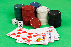 Playing chips and cards on green background Stock Photography