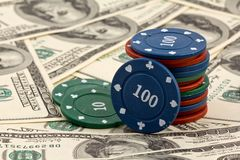Playing chips on a dollars background Royalty Free Stock Photos