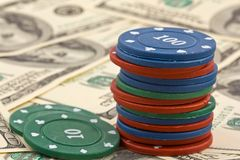 Playing chips on a dollars background Stock Photos