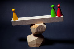 Playing chips on wooden beams, located on the top of the pyramid Royalty Free Stock Photos