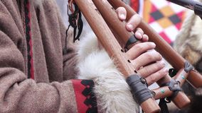 Chukchi musical instrument. Playing the Chukchi musical wind instrument stock footage