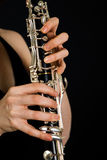 Playing on clarinet Royalty Free Stock Photos