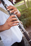 Playing clarinet. Street clarinet musicianPlaying clarinet in public Stock Photo
