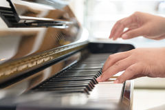 Playing classic piano Stock Image