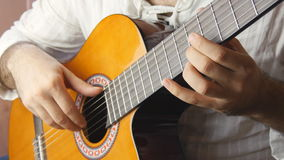 Playing classic spanish guitar stock footage