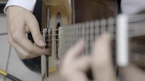 Playing classical guitar stock video