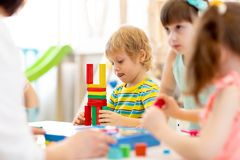 Playing with color block toys in kindergarten royalty free stock images
