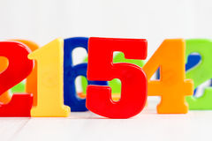 Playing with colored numbers Royalty Free Stock Photos