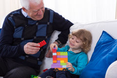 Playing with colorful blocks Royalty Free Stock Photos