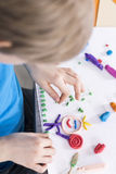 Playing with colorful plasticine stock image