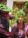 Playing with colours. Playing and celebrating holi Festival with my little brother Stock Photo