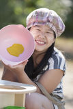 Playing cooking. Cute asian girls enjoy playing cooking royalty free stock images