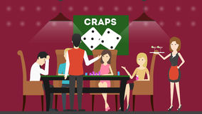 Playing craps in casino. People sit in the casino at the playing table and play craps Royalty Free Stock Images