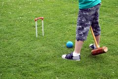 Playing croquet royalty free stock image