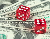 Playing cubes and money. Background from dollars and playing cubes, a close up Royalty Free Stock Photography