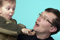 Playing dad and son. Playing father and son looking at each other stock photography