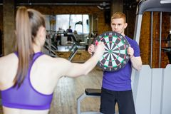 Playing darts in the gym. Royalty Free Stock Photography