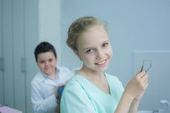 Playing dentist in the dental office. royalty free stock images