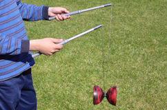 Playing diabolo. Boy playing diabolo, plenty of copy space on the right Stock Photography
