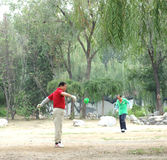Playing diabolo. People playing diabolo in Changhong park Tianjin China Royalty Free Stock Images