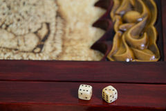 Playing dice on a game board Royalty Free Stock Photos