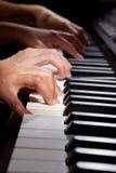 Playing digital hybrid piano Stock Image