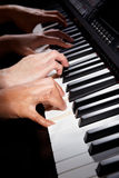 Playing digital hybrid piano Stock Photos