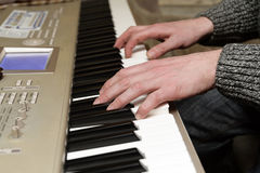 Playing the digital piano Royalty Free Stock Images