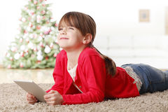 Playing on digital tablet Stock Images
