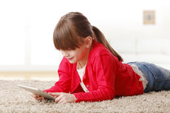 Playing on digital tablet Stock Photo