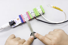Playing with dimmers. A child fingers playing with electronic circuits Royalty Free Stock Photo