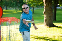 Playing disc golf Stock Photo
