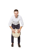 Playing the Djembe standing Royalty Free Stock Image