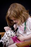 Playing doctor with a stuffed toy royalty free stock photography