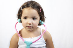 Playing doctor with toy stethoscope Royalty Free Stock Photography