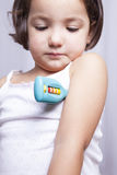 Playing doctor with toy thermometer Stock Image